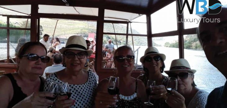 What do you think of tasting the Porto wine and sailing along the river Douro? - West Blue Dreams Porto Luxury Tours Portugal